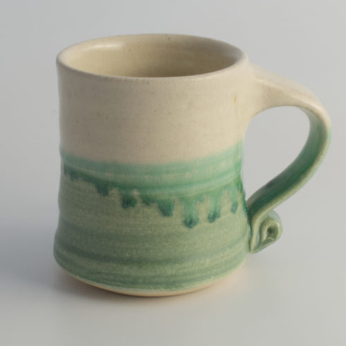 green & white ceramic mug