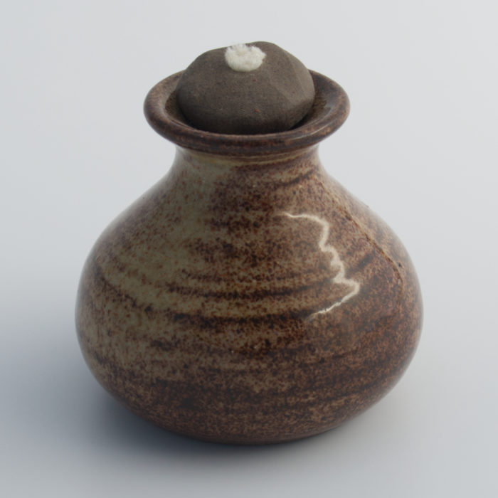 brown ceramic oil lamp