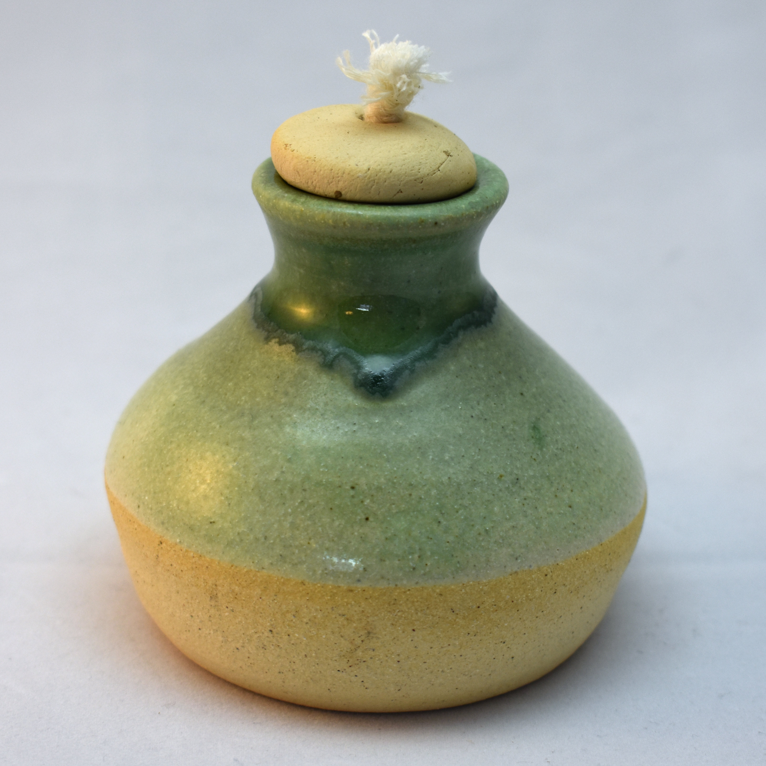 stoneware oil lamp with green glaze